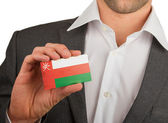 Businessman is holding a business card, Oman — Stock Photo
