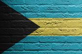 Tegelvägg med en målning av en flagga, bahamas — Stockfoto