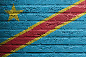 Brick wall with a painting of a flag, The Democratic Republic of — Stock fotografie