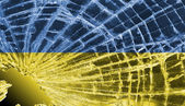 Broken glass or ice with a flag, Ukraine — Stock Photo