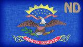 Linen flag of the US state of North Dakota — Stock Photo