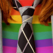 Caucasibusiness womwith tie, rainbow flag pattern — Stock Photo #24302531