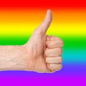 Bild von einem mans Hand Daumen, Regenbogenfahne anzeigen — Stockfoto