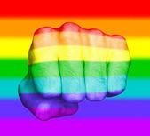 Fist of a man punching, rainbow flag pattern — Stock Photo