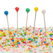 Straight pins in candy — Stock Photo