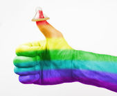Thumbs up, condom on thumb — Stock Photo