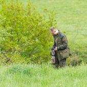 Wildlife photographer with long telephoto — Stock Photo