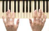 Piano keyboard with hand — Stock Photo