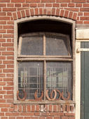 Horseshoes in front of a window — Stock Photo