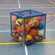 Collection of different balls in a metal cage — Stock Photo #28045351
