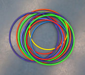 Hula-hoops on a blue school gym floor — Stock Photo
