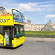 Stock Photo: PARIS - JULY 28, 2013. Excursion bus at the Louvre on July 28, 2
