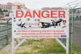 PRINCESS JULIANA AIRPORT, ST MARTIN - JULY 19, 2013: Warning sig — Stock Photo