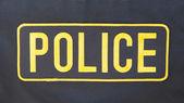 Sul retro di un cappotto di polizia — Foto Stock