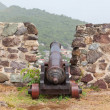 Very old rusted canon on top of an old wall — Stock Photo