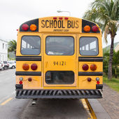 Yellow school bus parked — Stock Photo