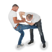 Man trying to kidnap another man, selfdefense, kicking in groin — Stock Photo