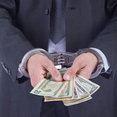Business man in handcuffs arrested for bribe — Stock Photo