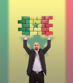 Biznesmen posiadający duży kawałek muru — Zdjęcie stockowe