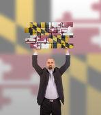 Imprenditore in possesso di un grosso pezzo di un muro di mattoni — Foto Stock