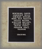 Coaching concept in plastic letters on very old menu board — Stock Photo
