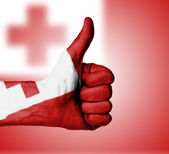 Closeup of male hand showing thumbs up sign — Stock Photo