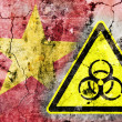 Old cracked wall with biohazard warning sign and painted flag — Stock Photo