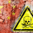 Old cracked wall with poison warning sign and painted flag — Stock Photo