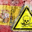 Old cracked wall with poison warning sign and painted flag — Stock Photo #36572127