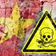 Old cracked wall with poison warning sign and painted flag — Stock Photo #36572195