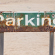 Old rusty parking sign — Stock Photo #38889177