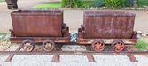 Rusted old mining carriages filled with stones — Stock Photo