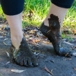 Stock Photo: Feet in mud close-up