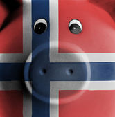 Ceramic piggy bank with painting of national flag  — Stock Photo