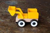 Simple wheel dozer toy — Stock Photo