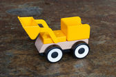 Simple wheel dozer toy — Stockfoto