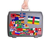Použitý plastový kufr s nálepkami — Stock fotografie