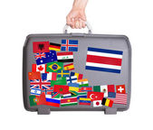 Gebrauchte kunststoff-koffer mit sticker — Stockfoto