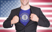 Businessman opening suit to reveal shirt with state flag — ストック写真