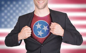 Businessman opening suit to reveal shirt with state flag — Stock Photo