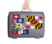 Used plastic suitcase with stains and scratches — Stock Photo