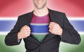 Businessman opening suit to reveal shirt with flag — Stock fotografie