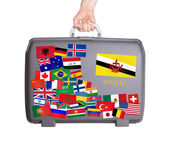 Used plastic suitcase with stickers — Стоковое фото