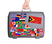 Used plastic suitcase with stickers — Stockfoto