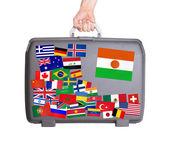 Używane walizka z tworzywa sztucznego z naklejkami — Zdjęcie stockowe