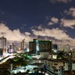 Stock Video: Timelapse - City at night with cloudscape under moonlight