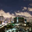 Timelapse - City at night with cloudscape under moonlight — Stock Video #12592863