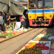 Train going through a Thai Food Market — Stock Video