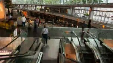Timelapse - walking down the mall escalators — Stock Video