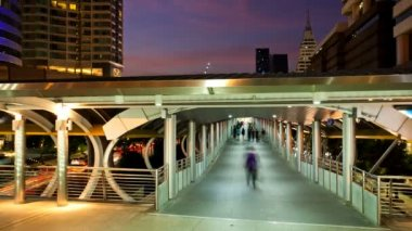 Timelapse - Pedestrians in Skytrain walkway — Stock Video